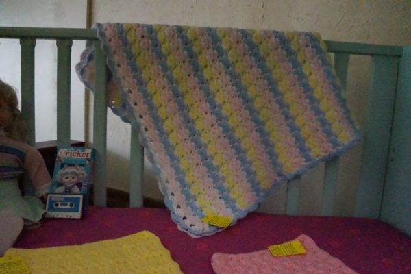 multi-colored hand crocheted baby afghan
